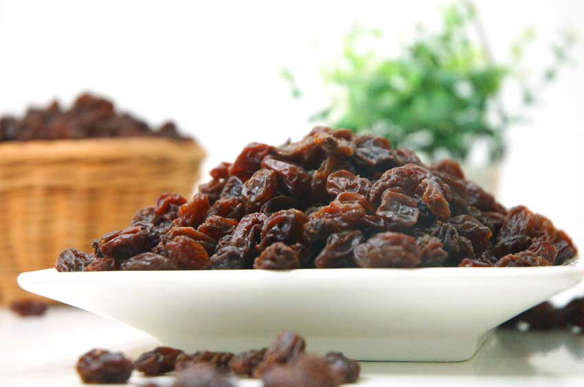 Bowl Of Raisins Sitting On A Table